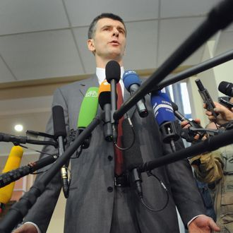 Russian billionaire Mikhail Prokhorov speaks to the media after receiving his certificate of presidential candidate in the Central Elections Commission office in Moscow, on January 25, 2012
