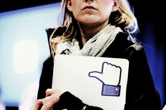 "MENLO PARK, CA - APRIL 04:  A Facebook employee holds a laptop with a ""like"" sticker on it during an event at Facebook headquarters during an event at Facebook headquarters on April 4, 2013 in Menlo Park, California. Facebook CEO Mark Zuckerberg announced a new product for Android called Facebook Home as well as the new HTC First phone that will feature the new software.  (Photo by Justin Sullivan/Getty Images)"