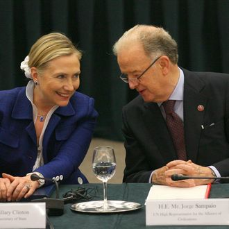 US Secretary Of State Hillary Clinton (L) listens to Portugal's former president and UN High Representative Jorge Sampaio as they take part in the Community Of Democracies ministerial conference in Vilnius on July 1, 2011. The Community of Democracies, an informal grouping of more than a hundred countries set up in 2000 to help cement freedoms worldwide, kicked off a two-day conference in the Baltic state of Lithuania yesterday. AFP PHOTO / PETRAS MALUKAS (Photo credit should read PETRAS MALUKAS/AFP/Getty Images)