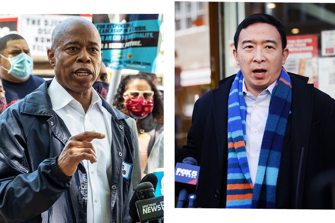 Eric Adams speaking on left to a crowd, Andrew Yang on the right