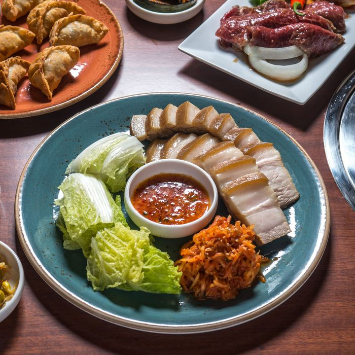 Bossam, meats for grilling, fried dumplings, kimchi — what more could you ask for?