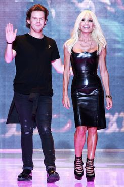 Designers Christopher Kane and Donatella Versace acknowledge the applause of the audience after the Versus Spring/Summer 2013 fashion show as part of Milan Womenswear Fashion Week on September 21, 2012 in Milan, Italy.