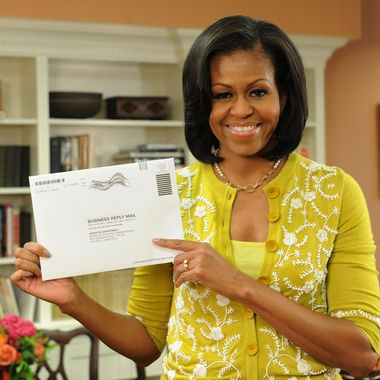 Washington, DC, USA-First Lady Michelle Obama prepares her absentee ballot for the upcoming elections.  OFA/Jocelyn Augustino?2012