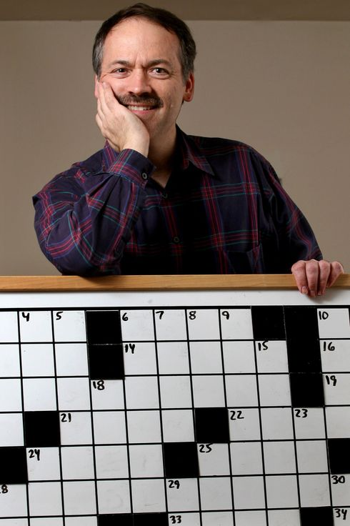 Will Shortz, founder of the American Crossword Puzzle Tournament and the New York Times's puzzle editor, poses Saturday, Feb. 23, 2008 in his Pleasantville, New York home with the contest board that is used during the competition that starts Feb. 29. Shortz hopes there will be more contestants and onlookers as it moves to Brooklyn, New York from 30 years at the former site in Stamford, Connecticut.  Photographer: Craig Ruttle/Bloomberg News