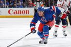 Carl Hagelin #62 of the New York Rangers skates with the puck against the Washington Capitals in Game One of the Eastern Conference Semifinals during the 2012 NHL Stanley Cup Playoffs at Madison Square Garden on
