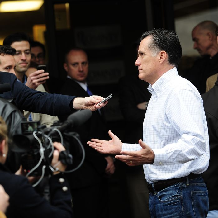 Republican presidential hopeful Mitt Romney talks to reporters after visiting his party headquarters in Greenville, South Carolina, January 21, 2012. South Carolina holds its Republican primary on January 21, 2012. AFP PHOTO/Emmanuel Dunand (Photo credit should read EMMANUEL DUNAND/AFP/Getty Images)