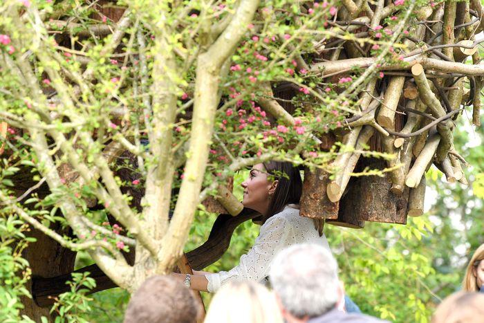 Kate Middleton climbing into a tree house.
