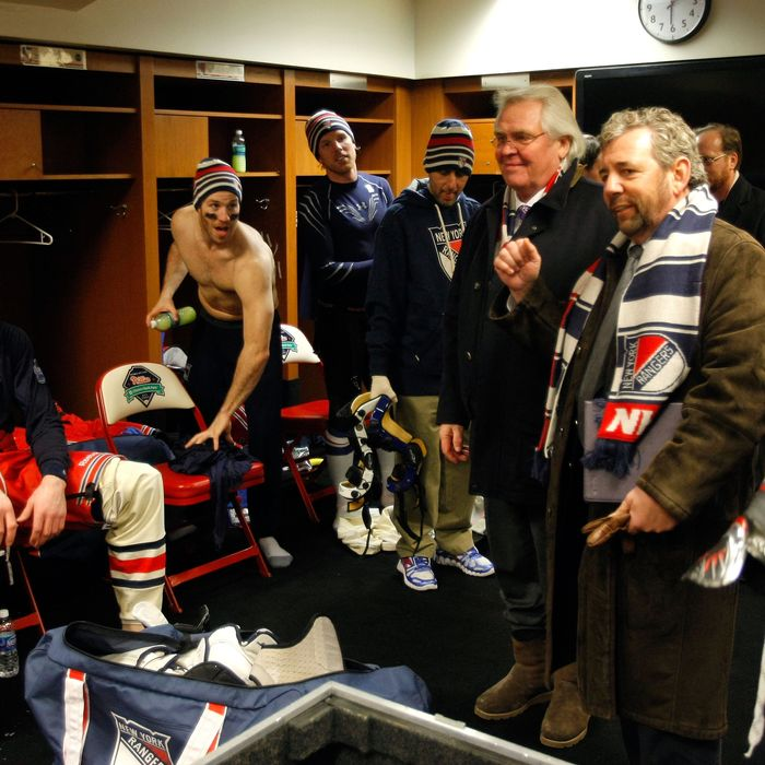 Glen Sather and James Dolan speak to the New York Rangers after they defeated the Philadelphia Flyers in the 2012 Winter Classic.