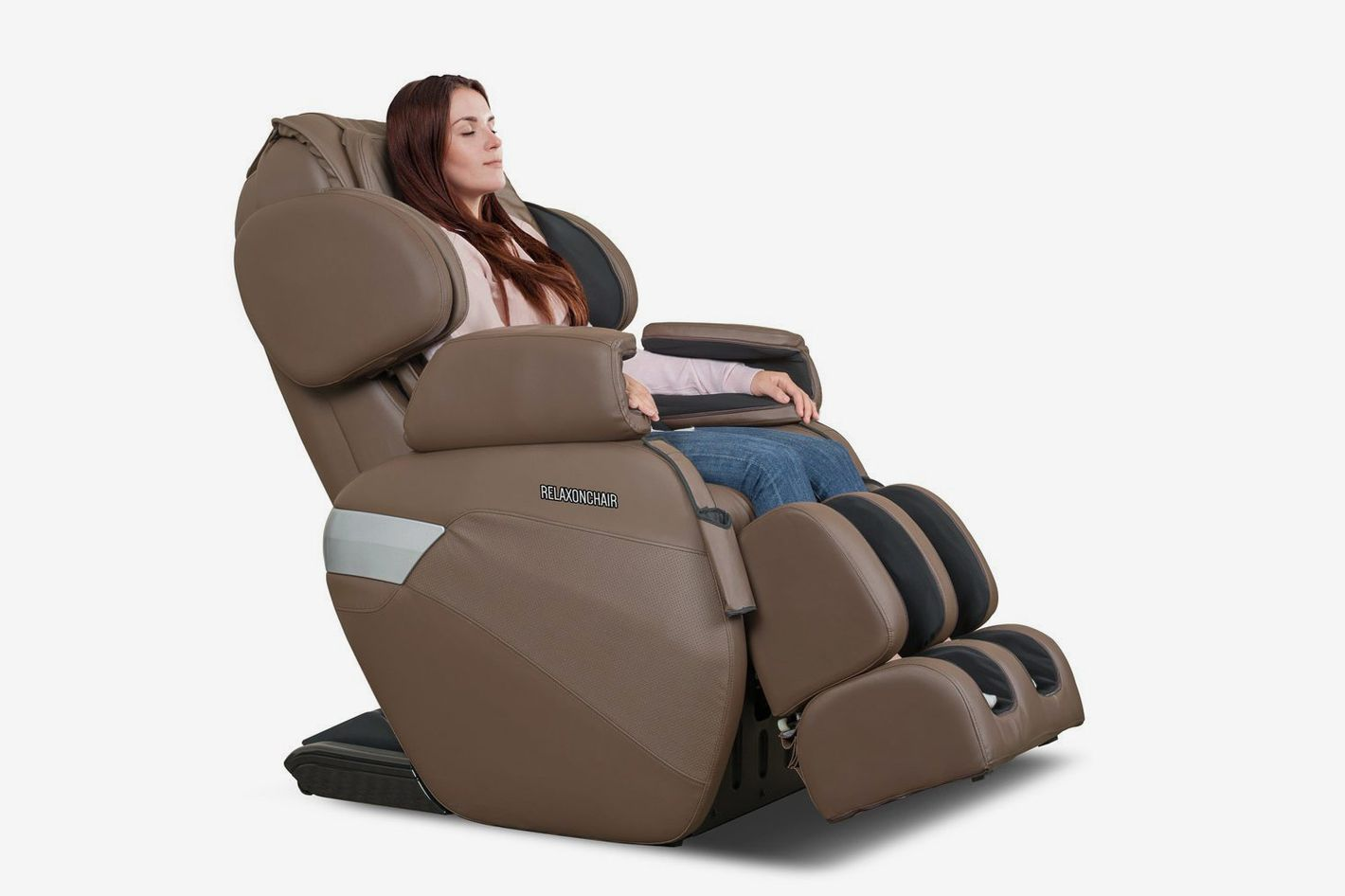 A brown massage recliner with a brunette woman sitting, eyes closed.