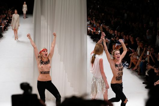 Activists of the feminist movement FEMEN protest on the catwalk as models present creations for Nina Ricci during the 2014 Spring/Summer ready-to-wear collection fashion show, on September 26, 2013 in Paris.