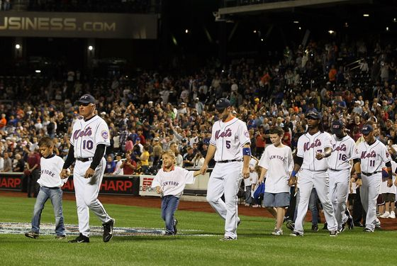 NEW YORK, NY - SEPTEMBER 11: Manager Terry Collins, David Wright #5, and Jose Reyes #7 of the New York Mets escort family members from Tuesday's Children during ceremonies honoring the tenth anniversary of the September 11 2001 terrorist attcks prior to the game between the New York Mets and Chicago Cubs at Citi Field on September 11, 2011 in the Flushing neighborhood of the Queens borough of New York City.  (Photo by Jim McIsaac/Getty Images)