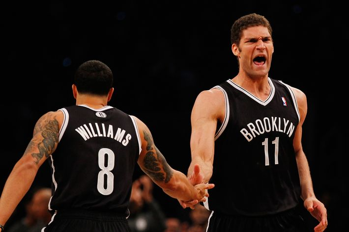 NEW YORK, NY - APRIL 20: Brook Lopez #11 of the Brooklyn Nets celebrates after hitting a basket with Deron Williams #8 against the Chicago Bulls during Game One of the Eastern Conference Quarterfinals of the 2013 NBA Playoffs at Barclays Center on April 20, 2013 in New York City. NOTE TO USER: User expressly acknowledges and agrees that, by downloading and or using this photograph, User is consenting to the terms and conditions of the Getty Images License Agreement. (Photo by Mike Stobe/Getty Images)