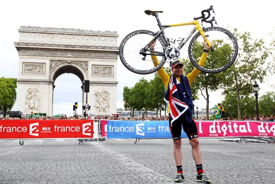 PARIS, FRANCE - JULY 24:  Cadel Evans of team BMC poses for photos as he takes part in a victory parade after winning the 2011 Tour de France after the twenty first and final stage of Le Tour de France 2011, from Creteil to the Champs-Elysees in Paris on July 24, 2011 in Paris, France.  (Photo by Michael Steele/Getty Images)