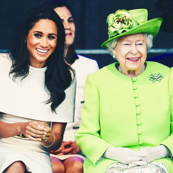Meghan Markle, hat-less, and Queen Elizabeth, in a hat.