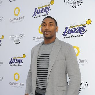 Metta World Peace #15 of the Los Angeles Lakers walks the purple carpet prior to attending Lakers Casino Night at Club Nokia at LA Live on March 10, 2013 in Los Angeles, Califronia.