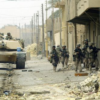A US marine with 3/5 marines Kilo company conduct a house-to-house search in the city of Fallujah 17 November 2004.