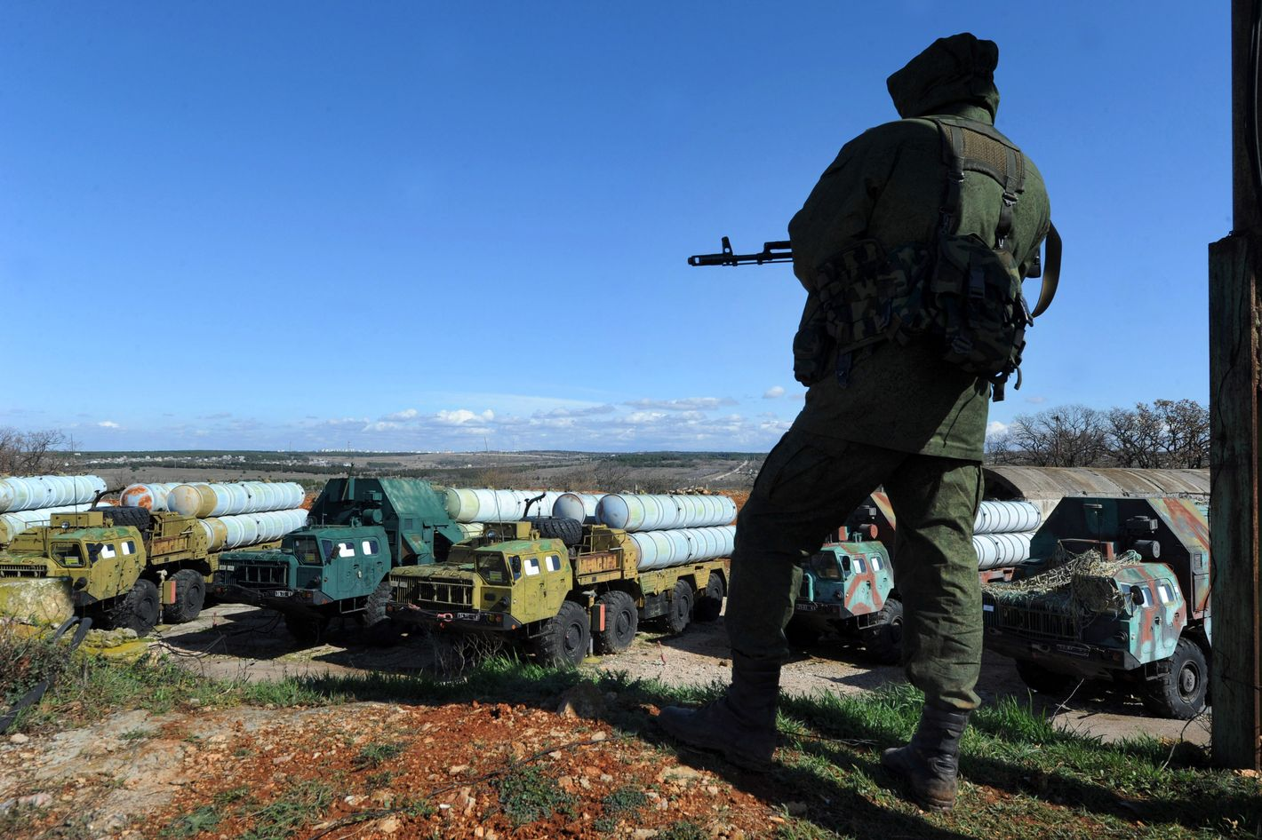 A member of the Russian forces guards in front of surface-to-air S300 missiles  in a Ukrainian anti-aircraft missile unit on the Cape of Fiolent in Sevastopol on March 5, 2014. A military source has told Interfax-Ukraine that Russian commandos have seized control of the anti-aircraft missile systems and are guarding them.
