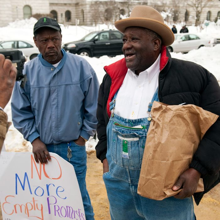 Johnny C. Green (left) and his cousin Willie Russell (right) of Eufaula, Alabama join other black farmers at a rally near the USDA building. There is an ongoing battle of black farmers in a civil rights lawsuit against federal government. A settlement is expected in the next few days. Photo will run along with a Q & A with head of USDA Tom Vilsack. Photos taken on February 15, 2010 in Washington, DC .