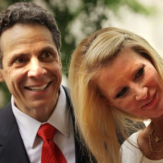 NEW YORK - MAY 22: New York Attorney General Andrew Cuomo stands on stage in the park with his girlfriend, Food Network host Sandra Lee, following his announcement to supporters that he is officially running for the Governor of New York outside the Tweed Courthouse on May 22, 2010 in New York City. For eleven years Cuomo's father, Mario, was the fifty-second Governor of the state. (Photo by Spencer Platt/Getty Images)