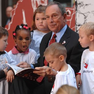 New York City Mayor Mayor Michael Bloomberg reads to children