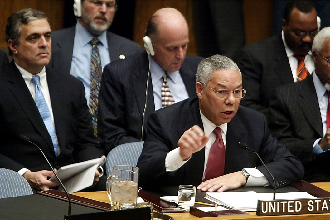 U.S. Secretary of State Colin Powell gestures during his address to the UN Security Council February 5, 2003 in New York City. Powell is making a presentation attempting to convince the world that Iraq is deliberately hiding weapons of mass destruction.