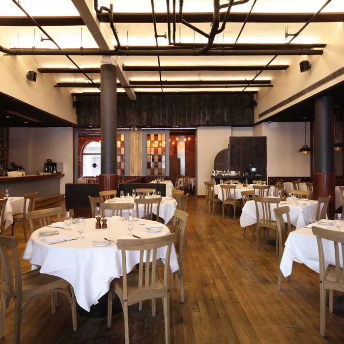 The refurbished dining room takes cues from the space's industrial past.