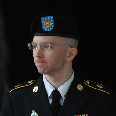 """Army Pfc. Bradley Manning is escorted from court on July 25, 2013 in Fort Meade, Maryland on July 25, 2013.  The trial of Manning, accused of """"aiding the enemy"""" by giving secret documents to WikiLeaks, is entering its final stage Thursday as both sides present closing arguments.  AFP PHOTO/Mandel NGAN        (Photo credit should read MANDEL NGAN/AFP/Getty Images)"""