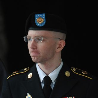 Army Pfc. Bradley Manning is escorted from court on July 25, 2013 in Fort Meade, Maryland on July 25, 2013. The trial of Manning, accused of