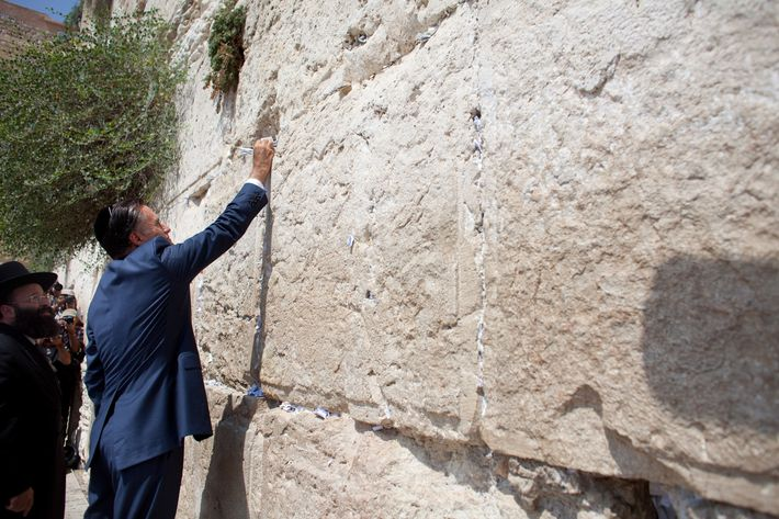 US Republican presidential candidate Mitt Romney places a hand-written prayer on the Western Wall on July 29, 2012 in Jerusalem's old city, Israel. Mitt Romney visits Israel as part of a three-nation foreign tour which also includes visits to Poland and Great Britain.
