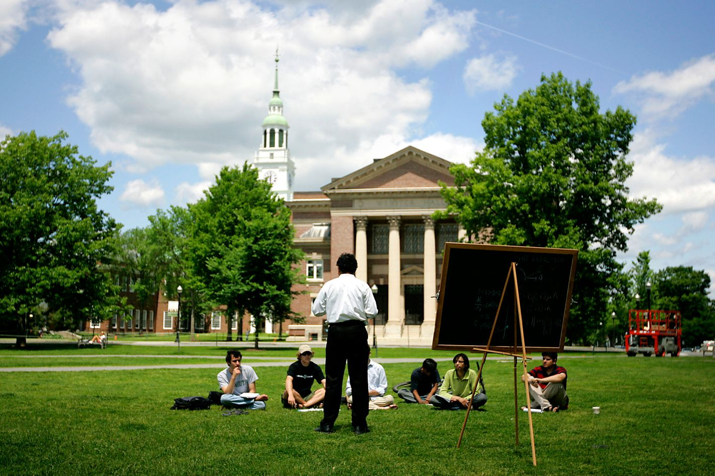 UNITED STATES - JUNE 02:  A group of students meet on the lawn outside Webster Hall on the campus of Dartmouth College, the smallest school in the Ivy League, in Hanover, New Hampshire, U.S., on Tuesday, June 2, 2009. Dartmouth, whose endowment was valued at $3.7 billion as of June 30, likely lost about 23 percent from that point through the end of March, Moody's Investors Service said May 27.  (Photo by Cheryl Senter/Bloomberg via Getty Images)