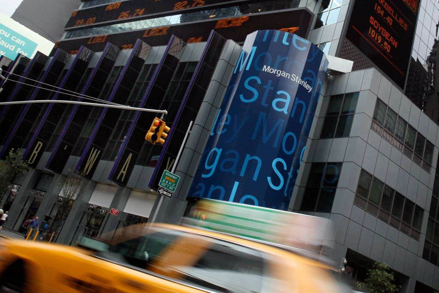 FILE  - In this file photograph taken July 19, 2010, traffic passes the headquarters of Morgan Stanley in New York. Of the 1,600 job cuts announced earlier in Dec. 2011 by Morgan Stanley, 580 will be at its home base in New York. (AP Photo/Richard Drew, file)