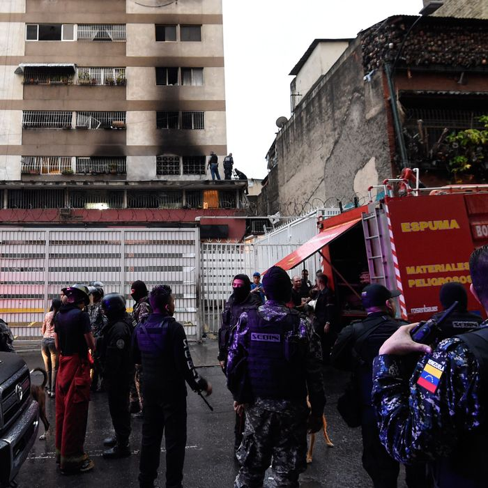 Security forces and members of the Sebin intelligence service check a nearby building after an explosion was heard while Venezuelan President Nicolas Maduro was attending a ceremony to celebrate the 81st anniversary of the National Guard, in Caracas on Saturday.