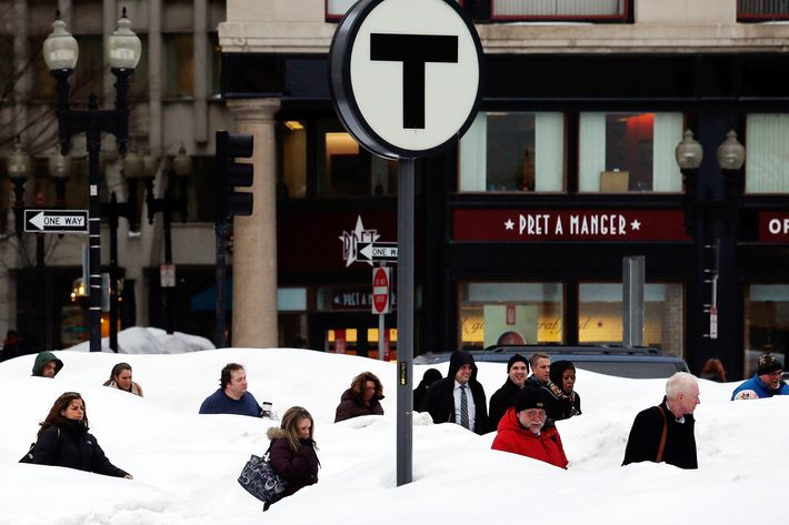 BOSTON - FEBRUARY 19: Pedestrians are obscured by snow banks in downtown Boston, Massachusetts February 19, 2015. (Photo by Jessica Rinaldi/The Boston Globe via Getty Images)