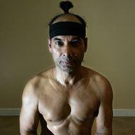 Yoga master Bikram Choudhury assumes the lotus position.