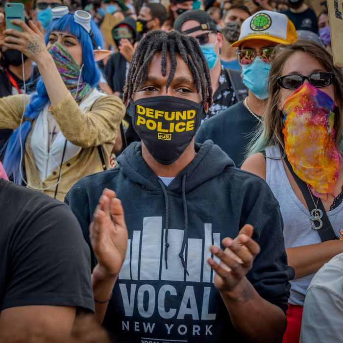 Protesters in New York wear 'Defund the Police' paraphernalia.