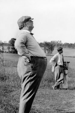 ca. 1890-1910 --- President William Howard Taft, known as much for his bulk as his office, stands in profile during a day on the golf course.  Taft served as President for one term (1908-1912). --- Image by © CORBIS