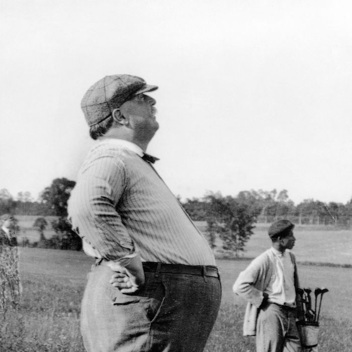 ca. 1890-1910 --- President William Howard Taft, known as much for his bulk as his office, stands in profile during a day on the golf course. Taft served as President for one term (1908-1912). --- Image by ? CORBIS