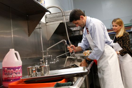 Republican vice presidential candidate, Rep. Paul Ryan, R-Wis., and his wife Janna wash pots at St. Vincent DePaul dinning hall, Saturday, Oct. 13, 2012 in Youngstown, Ohio.  (AP Photo/Mary Altaffer)