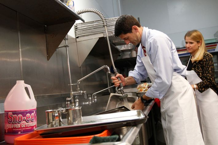 Republican vice presidential candidate, Rep. Paul Ryan, R-Wis., and his wife Janna wash pots at St. Vincent DePaul dinning hall, Saturday, Oct. 13, 2012 in Youngstown, Ohio.