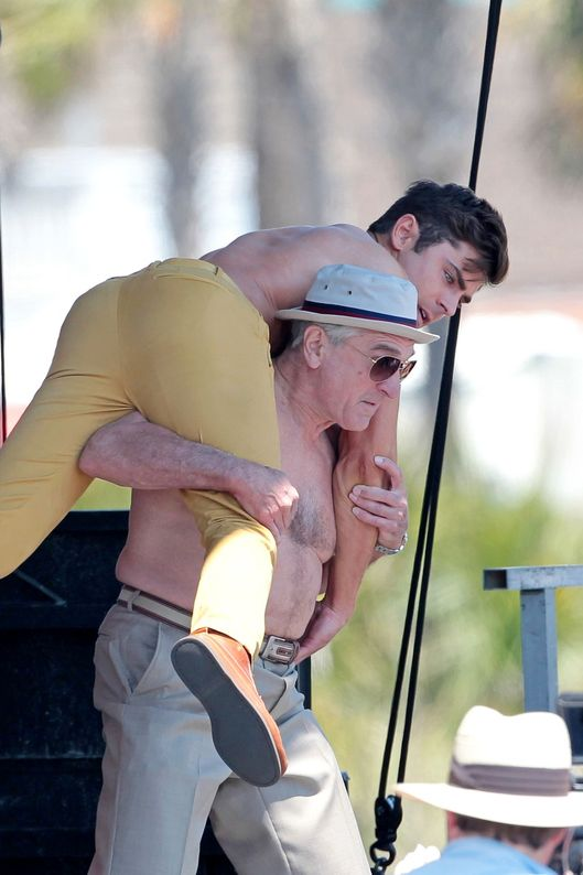 136465, Zac Efron and Robert De Niro show off slightly different physiques as they both go shirtless while filming a scene for 'Dirty Grandpa'. Zac and Robert had a flexing competition before 71 year old De Niro lifted 27 year old Zac up in the air. They were up on a stage overlooking a crowd of bikini clad beach-goers as they took off their shirts and flexed. Tybee Island, Georgia - Thursday April 30, 2015. Photograph: Bruja/Thibault, ? PacificCoastNews. Los Angeles Office: +1 310.822.0419 sales@pacificcoastnews.com FEE MUST BE AGREED PRIOR TO USAGE