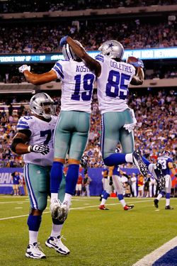 EAST RUTHERFORD, NJ - SEPTEMBER 05:  Wide receiver Kevin Ogletree #85 of the Dallas Cowboys  celebrates with wide receiver Miles Austin #19 and guard Mackenzy Bernadeau #73 after scoring a touchdown in the third quarter during the 2012 NFL season opener at MetLife Stadium on September 5, 2012 in East Rutherford, New Jersey.  (Photo by Jeff Zelevansky/Getty Images)