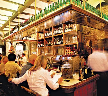 Seamus Mullen designed this snug, raffishly fashionable Iberian gastropub to evoke the smoky little cider houses of Northern Spain. But we're betting you won't find lustrously sweet-and-smoky sardines like this in the pubs of the Basque Country. Nor are you likely to come upon two-­fisted tapas interpretations like tosta huevo roto y jamón Ibérico, which packs the flavor of an entire ham-and-egg breakfast into one bite. For the authentic gastropub experience, sit in the back, next to the roaring, chimney-style oven, and order a raft of the ever-changing market-driven daily specials, which are scrawled in Spanish on blackboards hung on the redbrick walls.