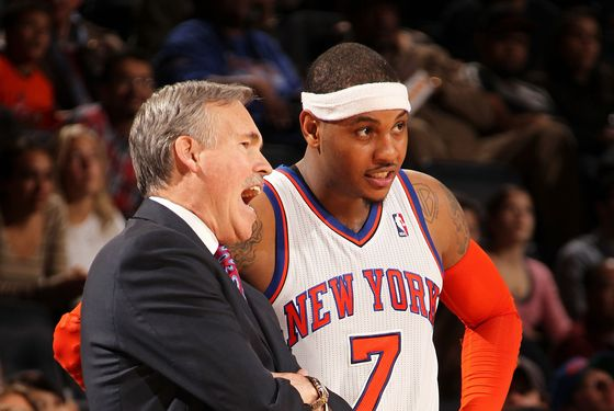 Mike D'Antoni of the New York Knicks talks to Carmelo Anthony #7 during the fourth quarter of a game against the Toronto Raptors on January 2, 2012 at Madison Square Garden in New York City.