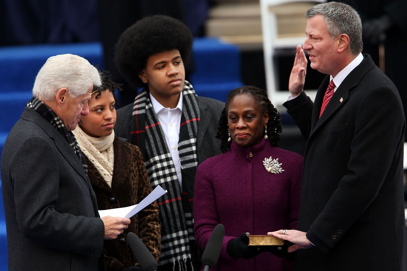 New York City's 109th Mayor, Bill de Blasio(right), is sworn in by former President Bill Clinton(left) as his family watches, Chiara de Blasio (2nd from left) Dante de Blasio (center) and wife Chirlane McCray (2nd from right) at City Hall on January 1, 2014 in New York City. Mayor de Blasio was sworn in using a Bible once owned by President Franklin Delano Roosevelt. Following the 12 years of the Michael Bloomberg administration, Mayor de Blasio won on a liberal platform that emphasized the growing gulf between the rich and poor in New York City.