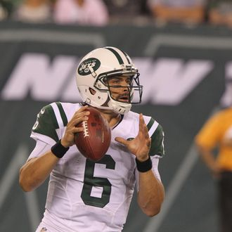 Quarterback Mark Sanchez #6 of the New York Jets drops to pass against the Jacksonville Jaguars at MetLife Stadium on August 17, 2013 in East Rutherford, New Jersey.
