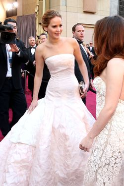 Actresses Jennifer Lawrence (L) and Kristen Stewart arrive at the Oscars held at Hollywood & Highland Center on February 24, 2013 in Hollywood, California.