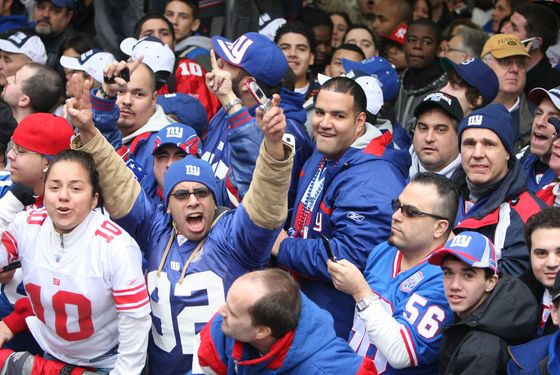 """NEW YORK - FEBRUARY 05:  New York Giants fans cheer the players as they pass in floats along Broadway, also known as """"The Canyon of Heroes"""" during Super Bowl XLII victory parade in New York City.  (Photo by Al Bello/Getty Images)"""