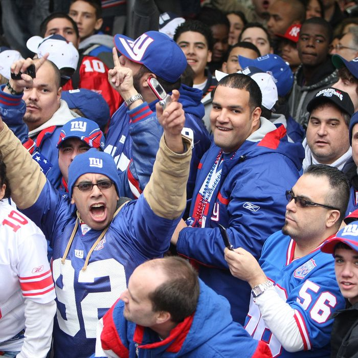 NEW YORK - FEBRUARY 05: New York Giants fans cheer the players as they pass in floats along Broadway, also known as