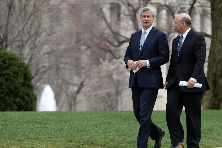 WASHINGTON - MARCH 27:  Jamie Dimon (L) CEO and chairman of JPMorgan Chase & Co, and Lloyd Craig Blankfein, CEO of The Goldman Sachs Group, Inc. walk away from the White House after a meeting with U.S. President Barack Obama at the White House March 27, 2009 in Washington, DC. Obama used the meeting to tell the bankers that they must look beyond short-term interests toward obligations each person has in order to make it through the current economic troubles.  (Photo by Mark Wilson/Getty Images) *** Local Caption *** Lloyd Craig Blankfein;Jamie Dimon
