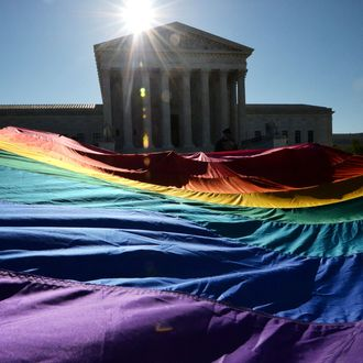 Supporters of same-sex marriages gather outside the US Supreme Court waiting for its decision on April 28, 2014 in Washington, DC. The US Supreme Court is hearing arguments on whether gay couples have a constitutional right to wed -- a potentially historic decision that could see same-sex marriage recognized nationwide.